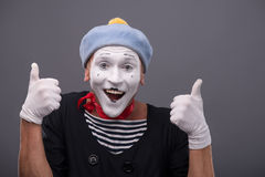 portrait-male-mime-white-funny-face-waist-up-grey-hat-showing-sign-ok-both-hands-looking-camera-44596756.jpg